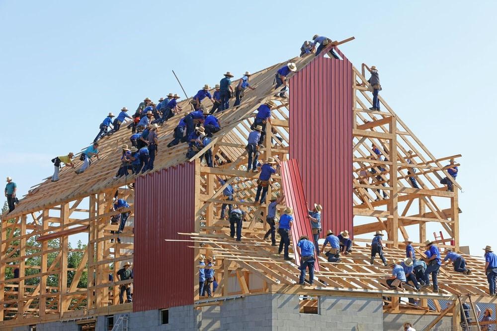 Mennonite community members building a barn.